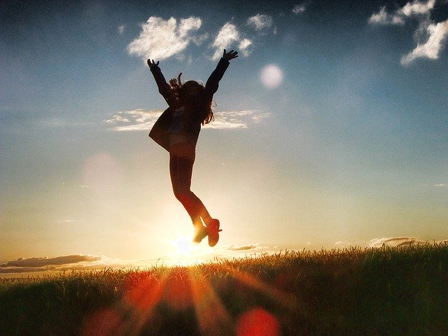 Woman jumps for joy at sunrise to celebrate a big lottery win